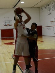 Corona junior Connor Cox goes for the lay up against