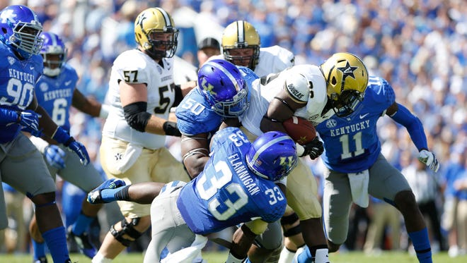 Vanderbilt running back Ralph Webb (26) runs with the ball against Kentucky in the first half at Commonwealth Stadium on Saturday.