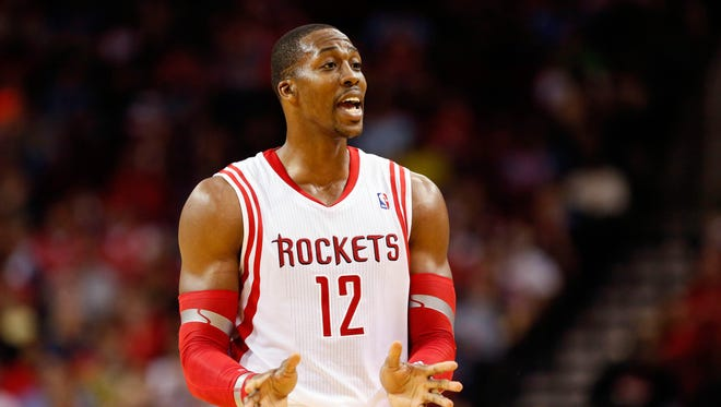 Houston Rockets center Dwight Howard (12) reacts during the second half against the Denver Nuggets at Toyota Center.