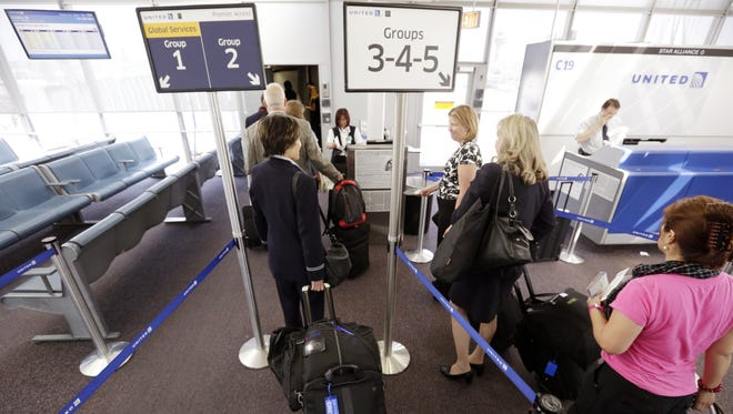 United Airlines passengers board a flight at O'Hare International Airport in Chicago.