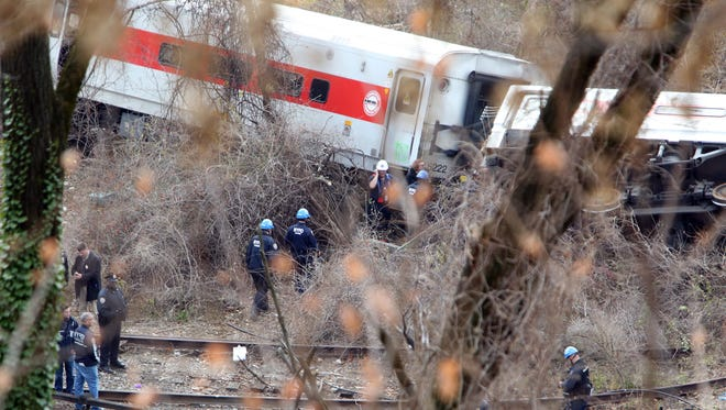 Emergency personnel survey the Metro-North train derailment near the Spuyten Duyvil station, Dec. 1, 2013 in the Bronx.