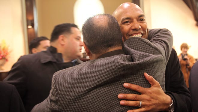 Former Yankees star Mariano Rivera greets people at the Refuge of Hope Church in New Rochelle on March 6, 2014. Rivera and his wife, Clara help restore the church after it was abandoned in the 1970s.