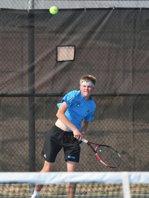 Pueblo West sophomore Nathan Kleven hits a first serve during he and his partner Travis Persons' No. 2 doubles victory over Pueblo County's Tyler Hylton and Hunter McClure on Aug. 25 at Pueblo West.