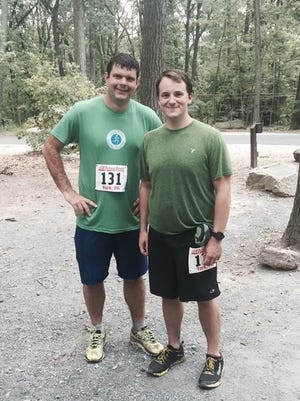Andy Sandrik, left, and Martin Speece after completing the On the Rocks 15K in York. Speece, an ultra-runner and Shippensburg U. graduate, plans on competing in the Oil Creek 100K on Oct. 8.