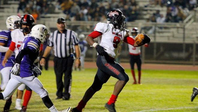 Seaside's Demarcus Hawkins scores a touchdown against Soledad on Friday.