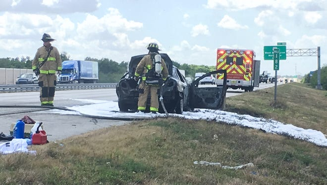 Both of the car's occupants made it out of their car unharmed after the vehicle caught fire on Interstate 95. April 4, 2018.