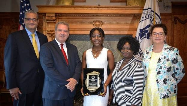 Mayor Mike Spano, second from left, gave his annual Mayor's Award to Samantha Mensah, center, who is graduating from Riverside High School on June 25, 2017.
