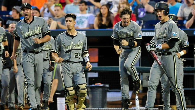 Vanderbilt players react to Zander Wiel's solo home run against TCU during the seventh inning of a game in the College World Series at TD Ameritrade Park, Tuesday, June 16, in Omaha, Neb.