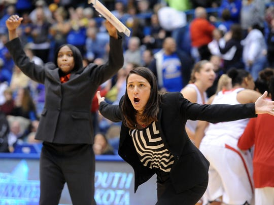 University of South Dakota's women's basketball head coach Amy Williams and graduate assistant coach Tandem Mays (left) call a full timeout against Western Illionois during the Summit Tournament at the Sioux Falls Arena on Sunday, March 9, 2014.(Jay Pickthorn/Argus Leader)