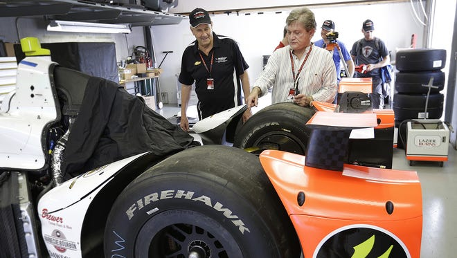 Team owners Tom Burns (right) and Bob Lazier, father of Buddy Lazier, look over the suspension of their No. 4 car May 12, 2016, at the Indianapolis Motor Speedway. Buddy will drive the car in the Indianapolis 500. The Laziers had been using No. 91, the 1996 winner.