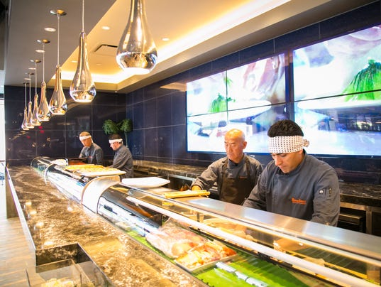 Kona Grill chefs prepare food