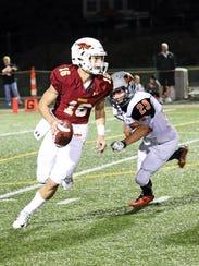 Ankeny High sophomore quarterback Hayes Gibson (16)