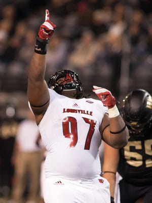 Oct 30, 2015; Winston-Salem, NC, USA; Louisville Cardinals defensive tackle DeAngelo Brown (97) celebrates after a big stop during the second quarter against the Wake Forest Demon Deacons at BB&T Field. Mandatory Credit: Jeremy Brevard-USA TODAY Sports