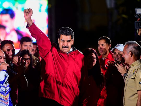 Venezuelan President Nicolas Maduro celebrates the