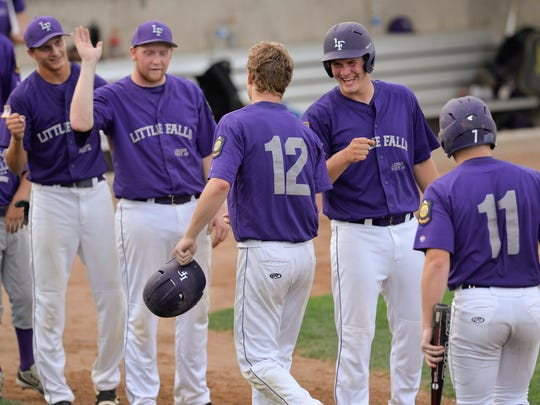 Little Falls players celebrate two of the four runs scored during the fourth inning of the Sub-State 12 American Legion baseball final against the St. Cloud 76ers Friday, July 22, at Dick Putz Field.