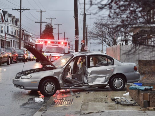 Officials tend to the scene of a crash Wednesday evening