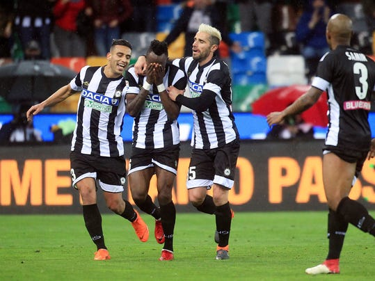 Udinese's Mohamed Seko Fofana, center, celebrates with his teammates after he scored during a Serie A soccer match between Udinese and Sassuolo, at the Friuli stadium of Udine, northern Italy, Saturday, March 17, 2018. (Stefano Lancia/ANSA via AP)