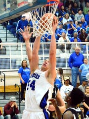 Cavemen junior center Brenden Boatwright jumps up for a dunk in the fourth quarter Saturday.