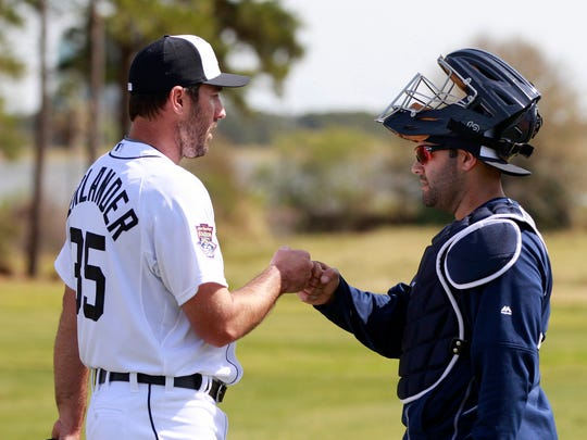 Tigers pitcher Justin Verlander fist-bumps catcher Alex Avila after Verlander finished a long throwing session in the bullpen during spring training on Feb. 21, 2015.