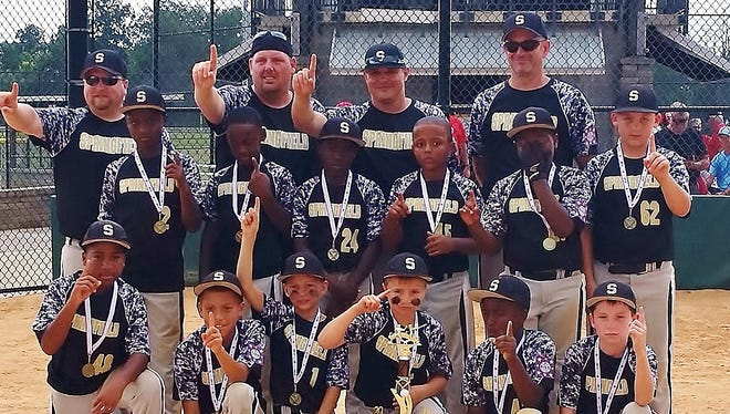 The Springfield 9-and-10-year-old All-Stars are all smiles after winning the  District 7 title.