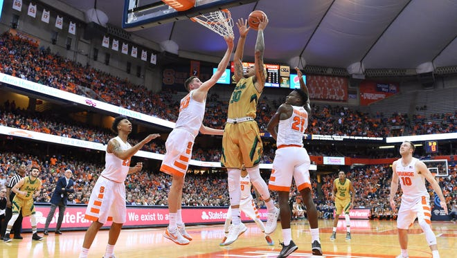 Notre Dame forward Zach Auguste shoots the ball between Syracuse forwards Tyler Lydon and Tyler Roberson (21) during a Jan. 28, 2016, game at the Carrier Dome.