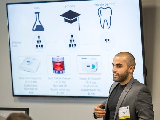 Farhad Baqi explains his business venture and product concept to guests at the University of Delaware's Summer Founders Program demo day at the Horn Center in Newark on Tuesday afternoon. Baqi's Curing Cube aims to revolutionize the way dental practices make molds.