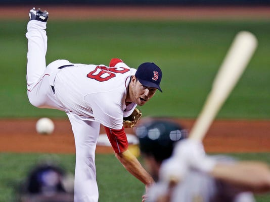 Boston Red Sox starting pitcher Doug Fister watches a throw during the first inning of a baseball game against the Oakland Athletics at Fenway Park in Boston, Wednesday, Sept. 13, 2017. (AP Photo/Charles Krupa)