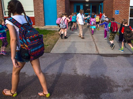 Principal Marcie Lewis greets students at the Westford Elementary School in May 2015.