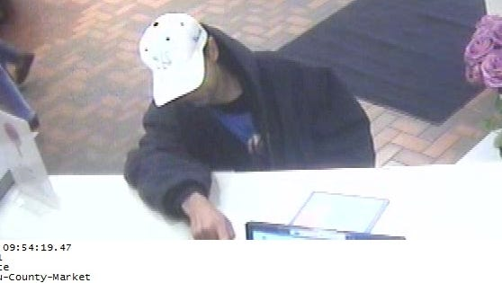 A photo of a bank robbery suspect inside Crossroads County Market in Wausau. It happened at about 10 a.m. Monday.