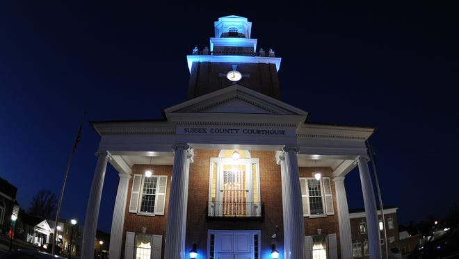 """040213-Georgetown,DE.-dcpstyle.autism-The Sussex County Courthouse has blue lights as State and County buildings were lit with blue lights for Autisms """"Light It Up Blue"""" campaign for April. Photographer / Daily Times / Chuck Snyder"""