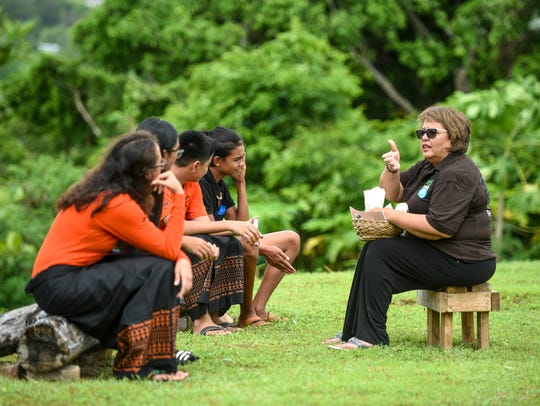 Zita Pangelinan, right, Håya Foundation president, sits with CHamoru immersion students at the Sågan Kotturan CHamoru Cultural Center in this Aug. 3, 2018, file photo.