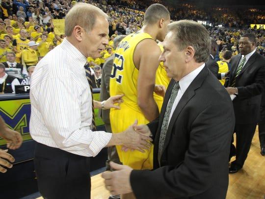 Michigan basketball coach John Beilein, left, and Michigan State coach Tom Izzo shake hands Jan. 17, 2012.
