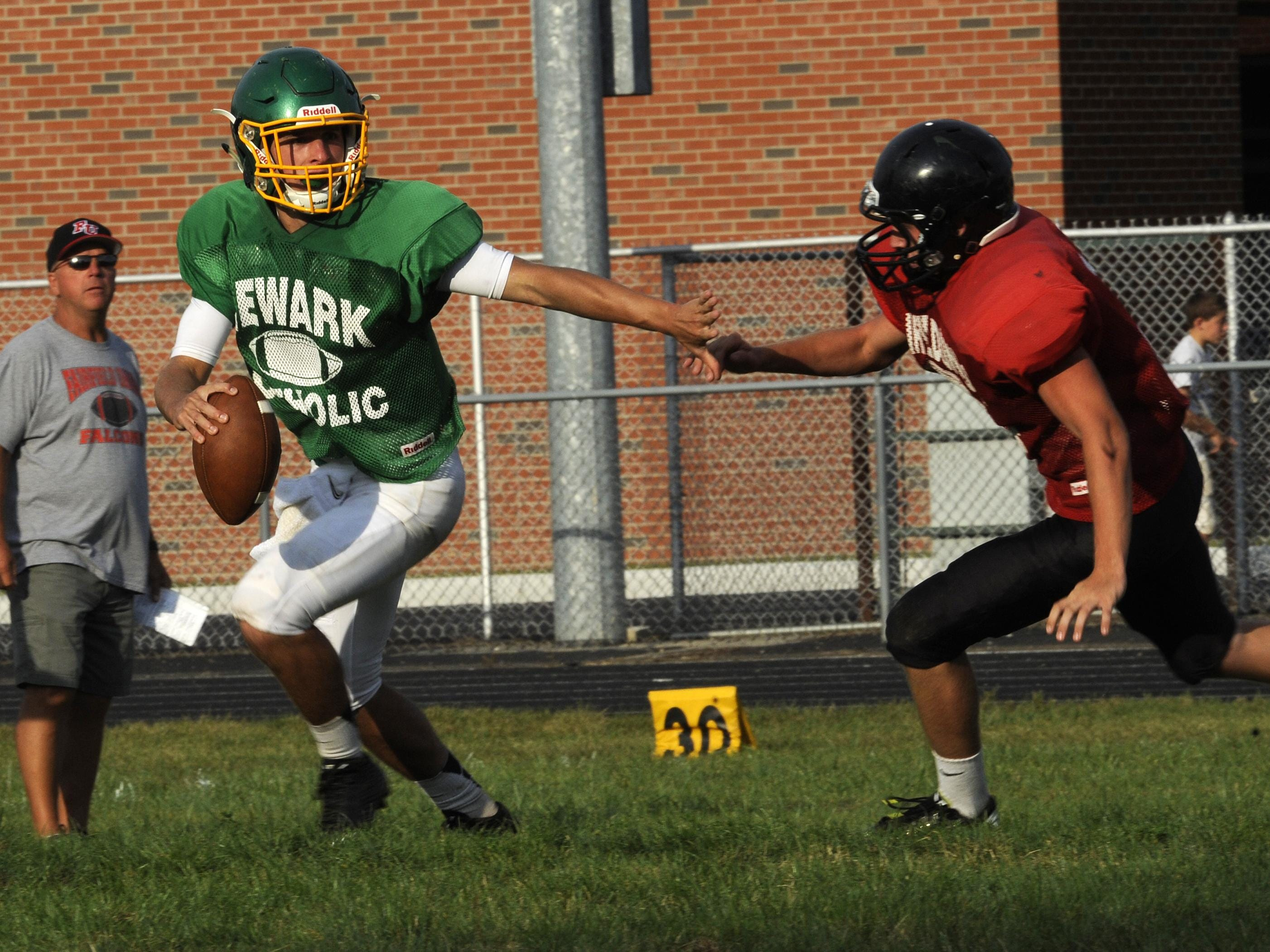 Newark Catholic's Kris Goodman attempts to elude a Fairfield Union defender during an August scrimmage. He threw for a touchdown and ran for another in a Week 1 win.