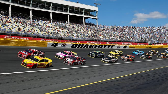 Joey Logano (22) leads the field during a restart at the Bank of America 500 at Charlotte Motor Speedway.