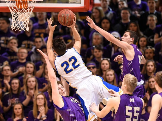 Cathedral's Isiah Anderson puts up a shot against Tim