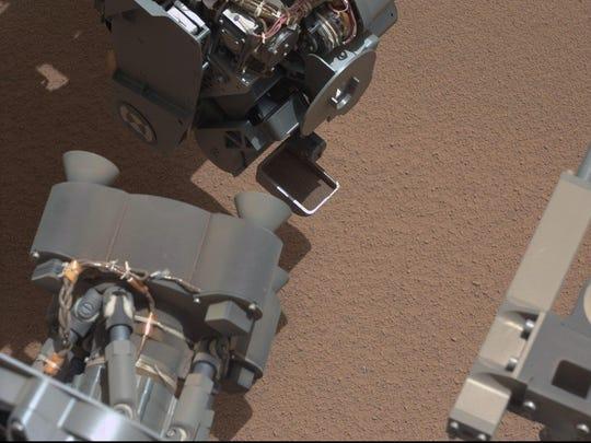 Rover scoop glints