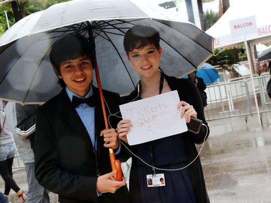 Fans in the rain at Cannes