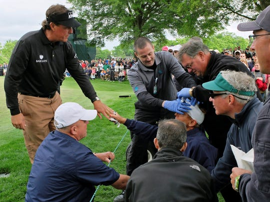2013-5-4 mickelson hits a spectator