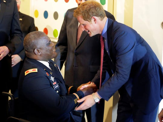 Prince Harry greets a veteran