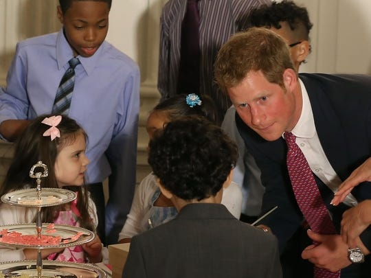 Prince Harry with kids