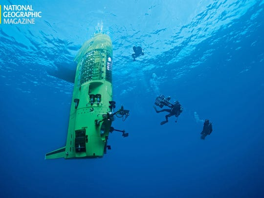 Divers wrangle a 3-D camera