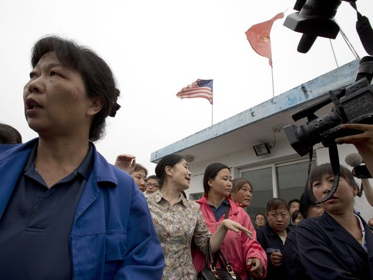 China workers hold executive hostages