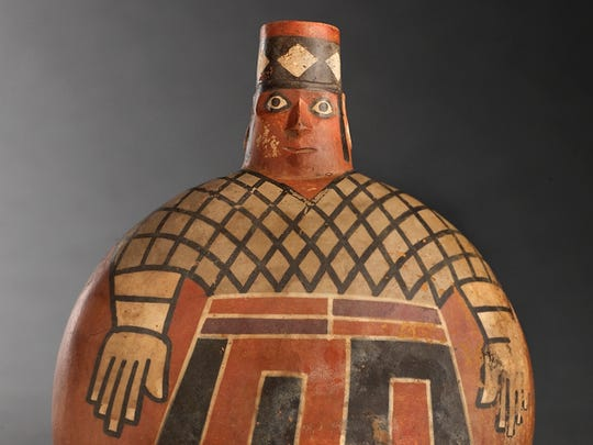 A painted Wari lord on a flask.