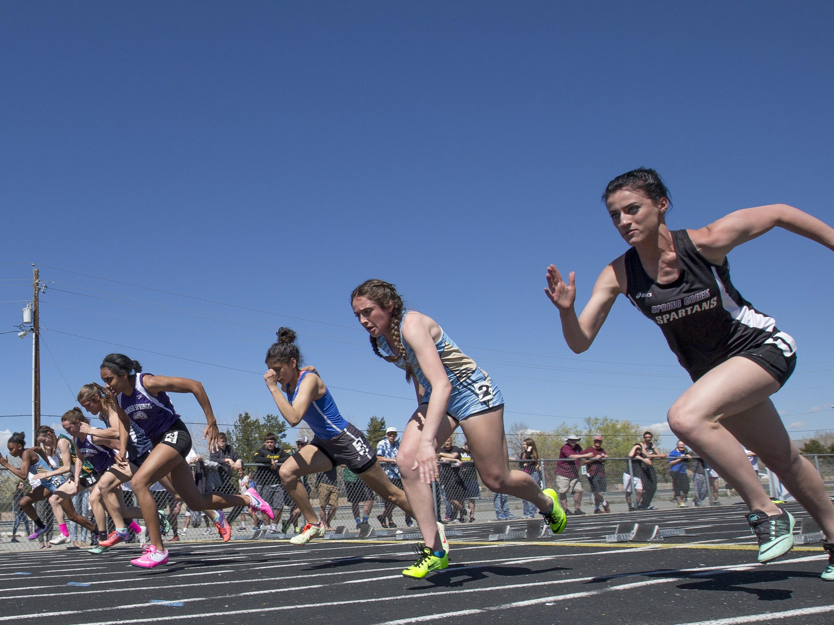 The start of the girls 100-meters during the Reed Rotary track meet on Saturday at. Spanish Springs' Jessica Ozoude, fourth from right, won the event and set a new track record.