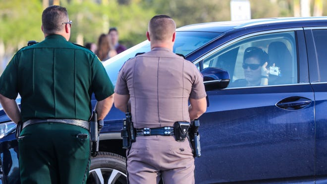 The teachers of Stoneman Douglas High School reported back to their classrooms almost two weeks after the February 14th school shooting that claimed the lives of 17 students and teachers. Only employees with school badges were let in. A small group of supporters showed up with signed and waved and cheered as the teachers arrived.