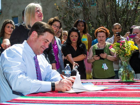 Gov. Doug Ducey signs Senate Bill 1350 that ensures that Arizonans can use homesharing services like Airbnb and HomeAway without restrictions from city governments.