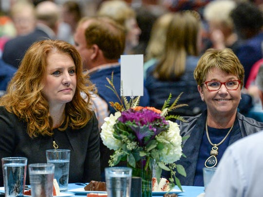 Kimberly Spears, left, the city of Anderson's new economic development director, sits next to City Manager Linda McConnell an event honoring the 2017 Class of 20 Under 40 at the Civic Center of Anderson in October.