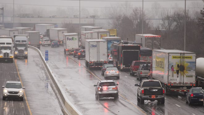A night of freezing rain caused myriad slip-offs and crashes on Indianapolis's roads, including northbound I-465 near 71st Street. Sub-freezing temperatures expected tonight, combined with rain forecast for throughout today, will compound the poor travel conditions.