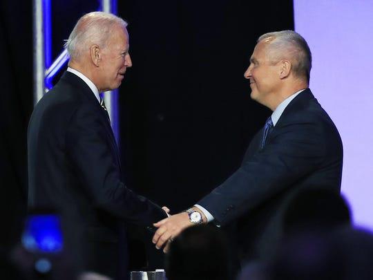 Former Vice President Joe Biden is greeted by International