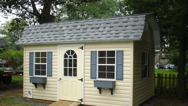 This 10-by-14-foot Dutch-style shed is covered in vinyl siding and would be an attractive, as well as practical, addition to a homeowner's backyard.